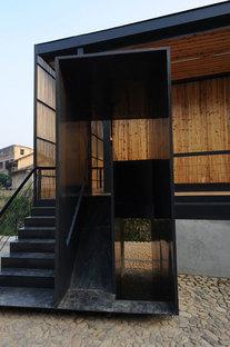 Li Xiaodong y la escuela sobre el puente