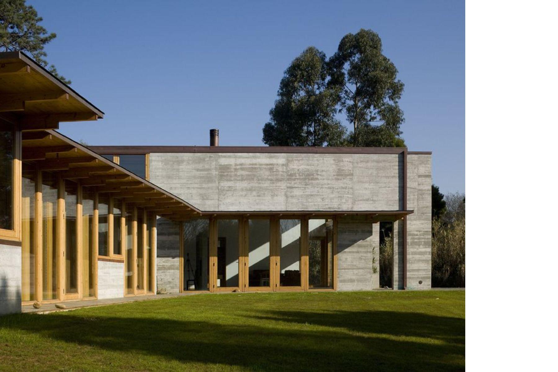 Castanheira una casa de cemento y madera floornature - Casas de madera y cemento ...