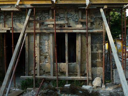 Ignatov Architects: nuevas oficinas construidas sobre la construcción histórica